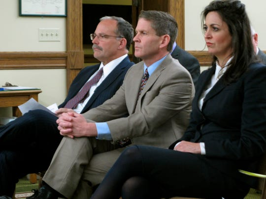 In this Nov. 13, 2018 photo, Montana Secretary of State Corey Stapleton is flanked by his elections director, Dana Corson, and chief of staff Christi Jacobsen as they wait to testify before a legislative committee in Helena, Mont. Corson and Stapleton detailed plans this week on spending a $3 million federal grant to improve election security.