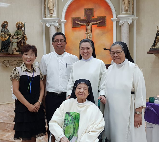 Sister Imelda celebrated her 88th birthday on Nov. 13 at the St. Dominic's Senior Care Home. A birthday prayer was said for the special intention of Sister Imelda's healing of her health. Pictured from left: Yeon Sook Park, Rev. Dan Bien, Sister Teresita Manaloto OP, Sister Ursula Apacionado, OP and Sister Imelda Aquino, OP.