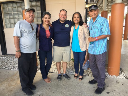 Sinajana Mayor Robert Hofmann congratulates participants in the Senior Law Clinic workshop presented by the Guam Bar Association held Nov. 15 at the Sinajana Senior Citizens Center. Pictured from left: Ricardo Sablan; Rose S. Cunic; Mayor Robert Hofmann; Mair S. Babauta and Alejo Sablan.