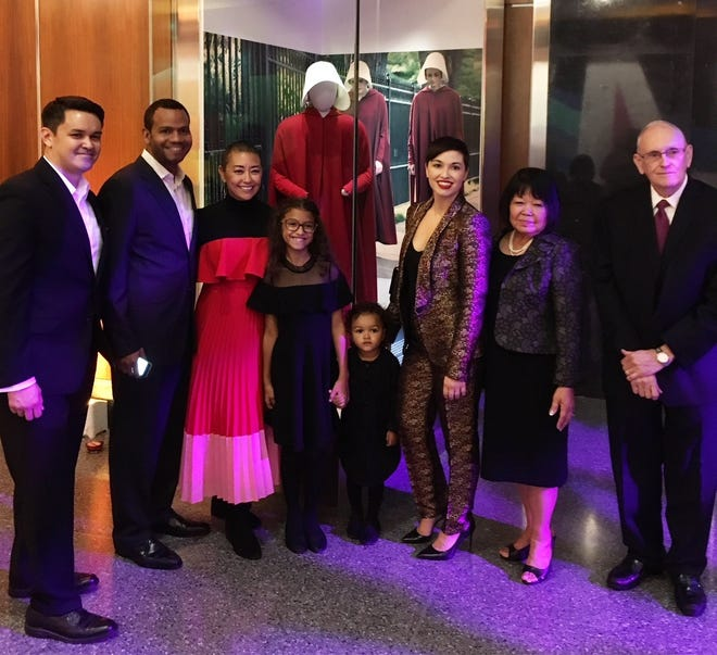 "Henderson native Ane Crabtree, who designed the iconic costumes on ""The Handmaid's Tale,"" poses with family at the Smithsonian Institution's National Museum of American History. From left to right are Shawn Crabtree, Roy Hurst, Ane Crabtree, Penelope Gilbert, Hiromi Gilbert, Hana Gilbert, Kimiko Crabtree and Charles Crabtree III."