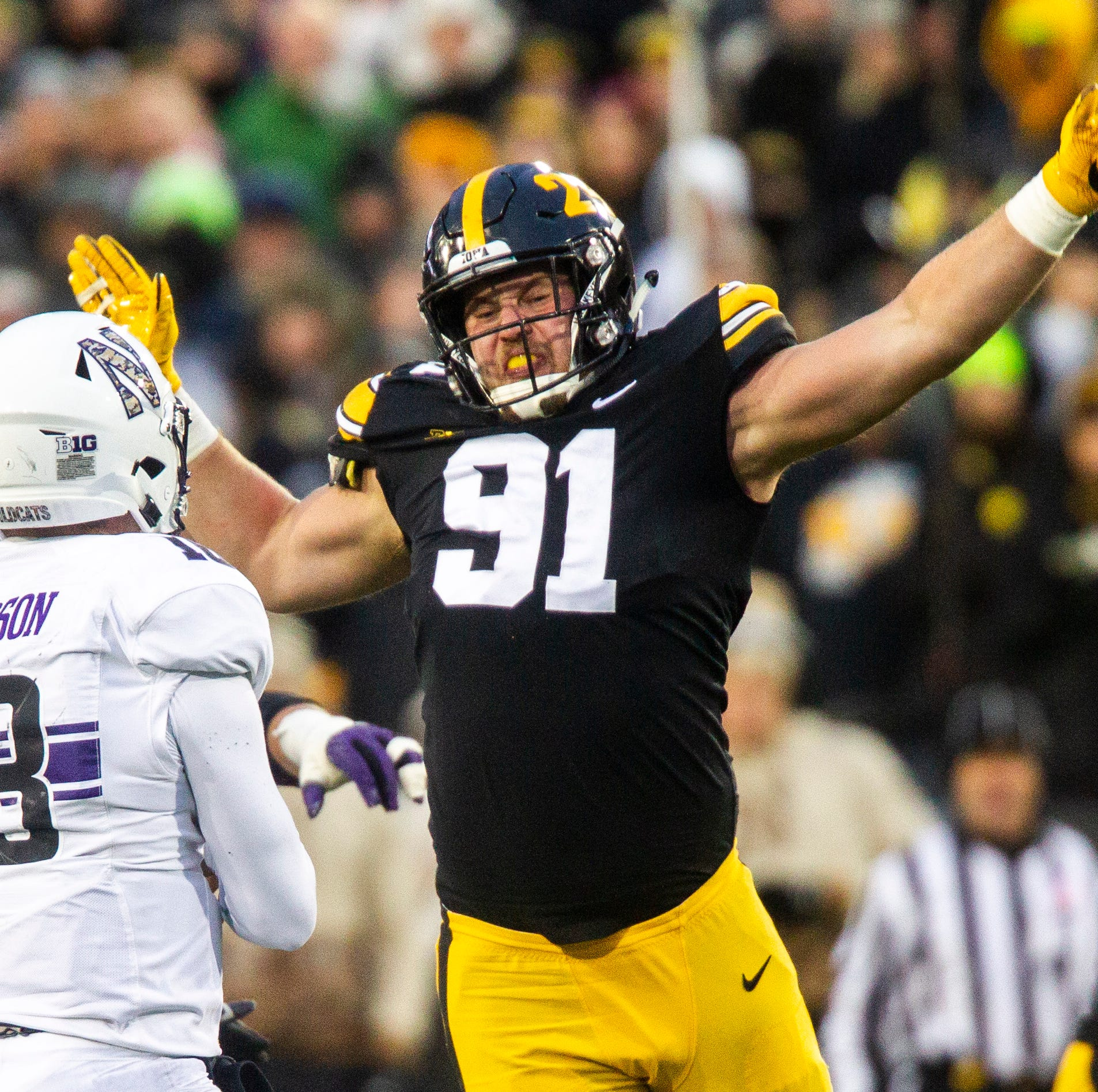 Iowa defensive lineman Brady Reiff (91) gets his hands up to attempt to block a pass during a Big Ten Conference football game on Saturday, Nov. 10, 2018, at Kinnick Stadium in Iowa City.