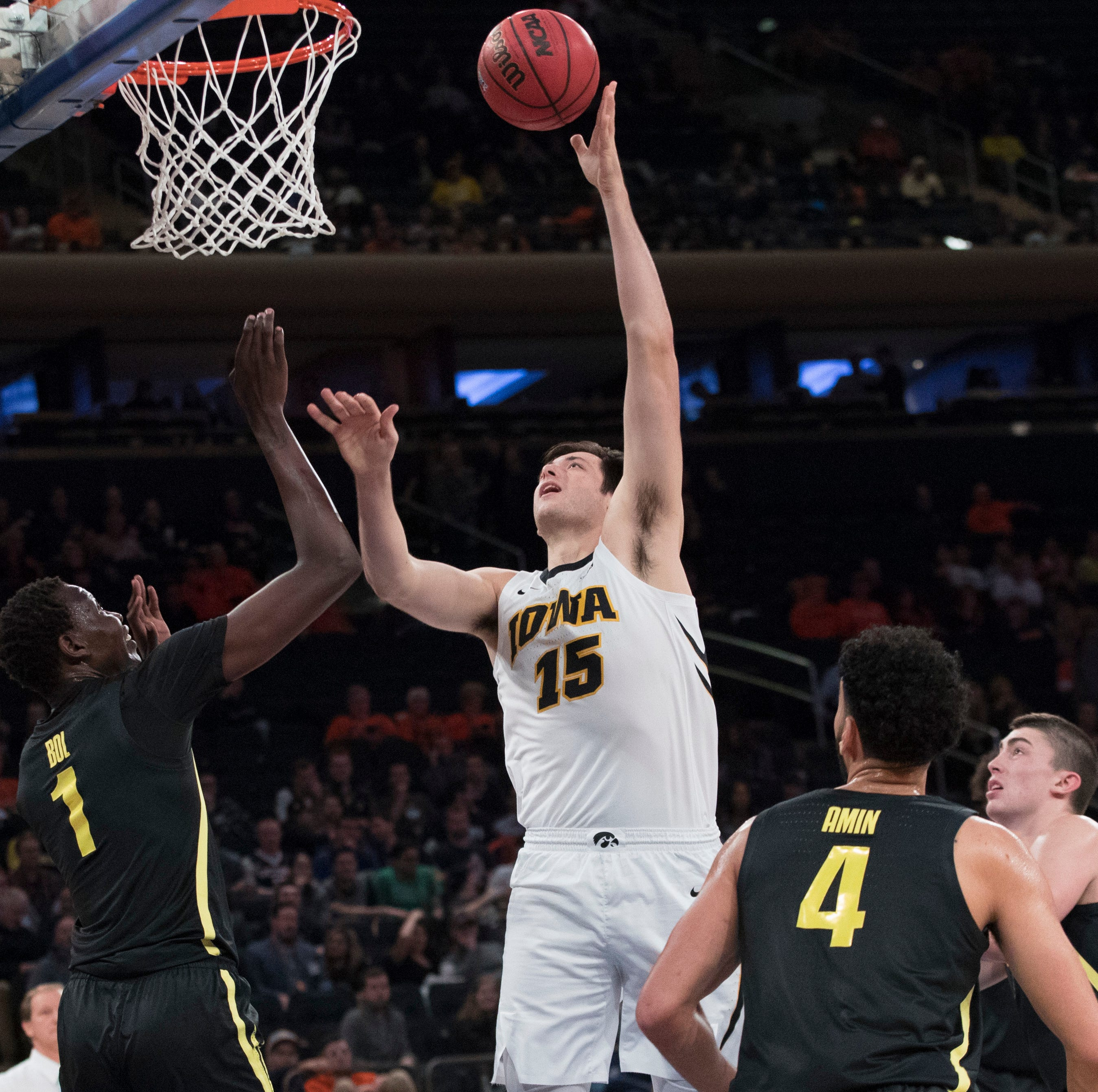 Iowa knocks off No. 13 Oregon in tenacious effort at Madison Square Garden