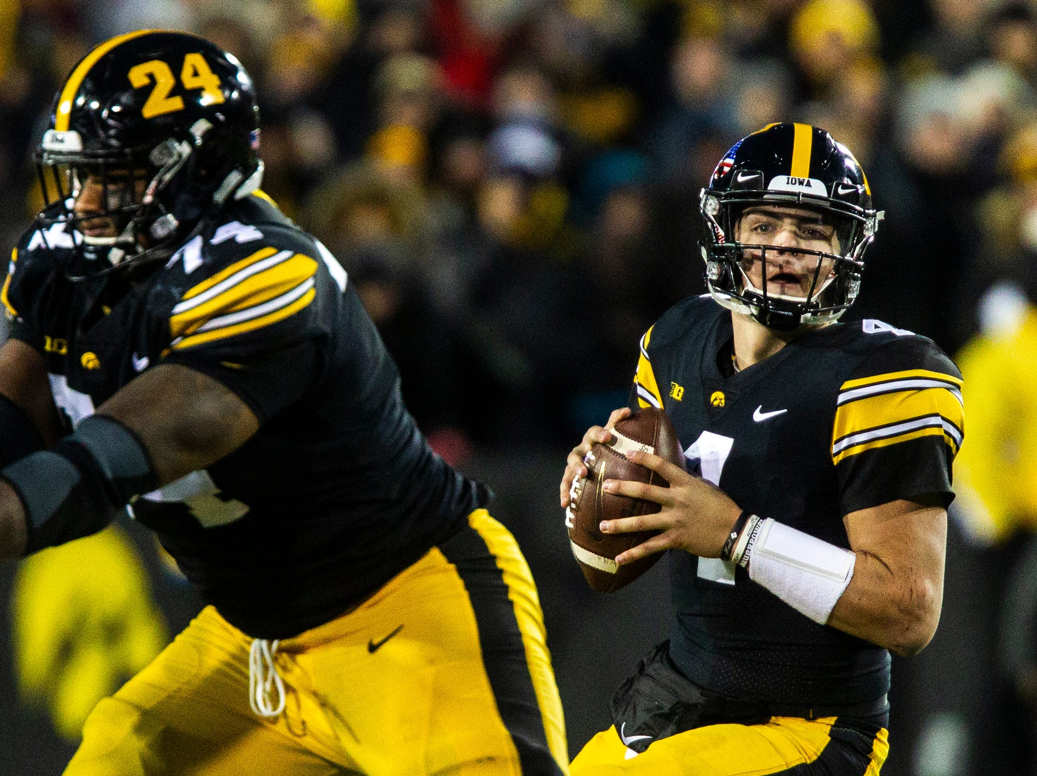 Iowa quarterback Nate Stanley (4) drops back to pass during a Big Ten Conference football game on Saturday, Nov. 10, 2018, at Kinnick Stadium in Iowa City.
