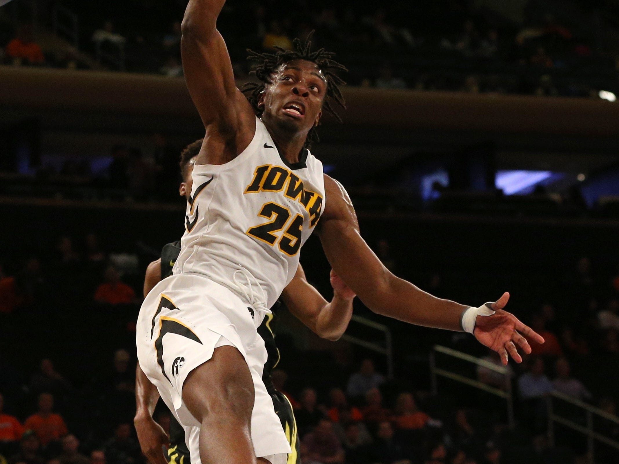 Nov 15, 2018; New York, NY, USA; Iowa Hawkeyes forward Tyler Cook (25) dunks against the Oregon Ducks during the first half at Madison Square Garden.