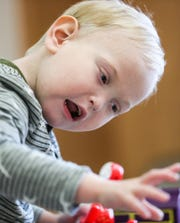 Four-year-old Sebastian Alles, born with Stage 4 chronic kidney disease, plays with toys at Riley Children's Hospital in Indianapolis, Friday, Nov. 16, 2018. Nicole and Justin Alles, experienced foster parents, took in 7-week-old Sebastian for what they thought would be short-term placement. His parents terminated their rights and the Alles family adopted Sebastian at age 2 and Nicole donated her own kidney to Sebastian at age 3.