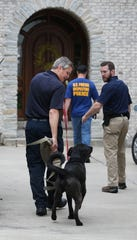 Bear enters the Zionsville home of then Subway spokesperson Jared Fogle along with other law enforcement during a morning-long investigation at Fogle's home on July 7, 2015.
