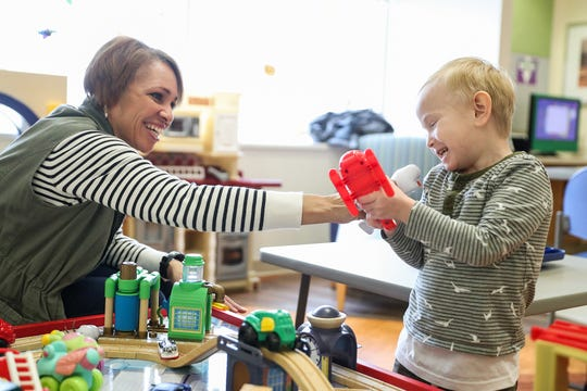 Nicole Alles and her four-year-old son Sebastian, born with Stage 4 chronic kidney disease, laugh together at Riley Children's Hospital in Indianapolis, Friday, Nov. 16, 2018. Alles and her husband Justin, experienced foster parents, took in 7-week-old Sebastian for what they thought would be short-term placement. His parents terminated their rights and the Alles family adopted Sebastian at age 2 and Nicole donated her own kidney to Sebastian at age 3.