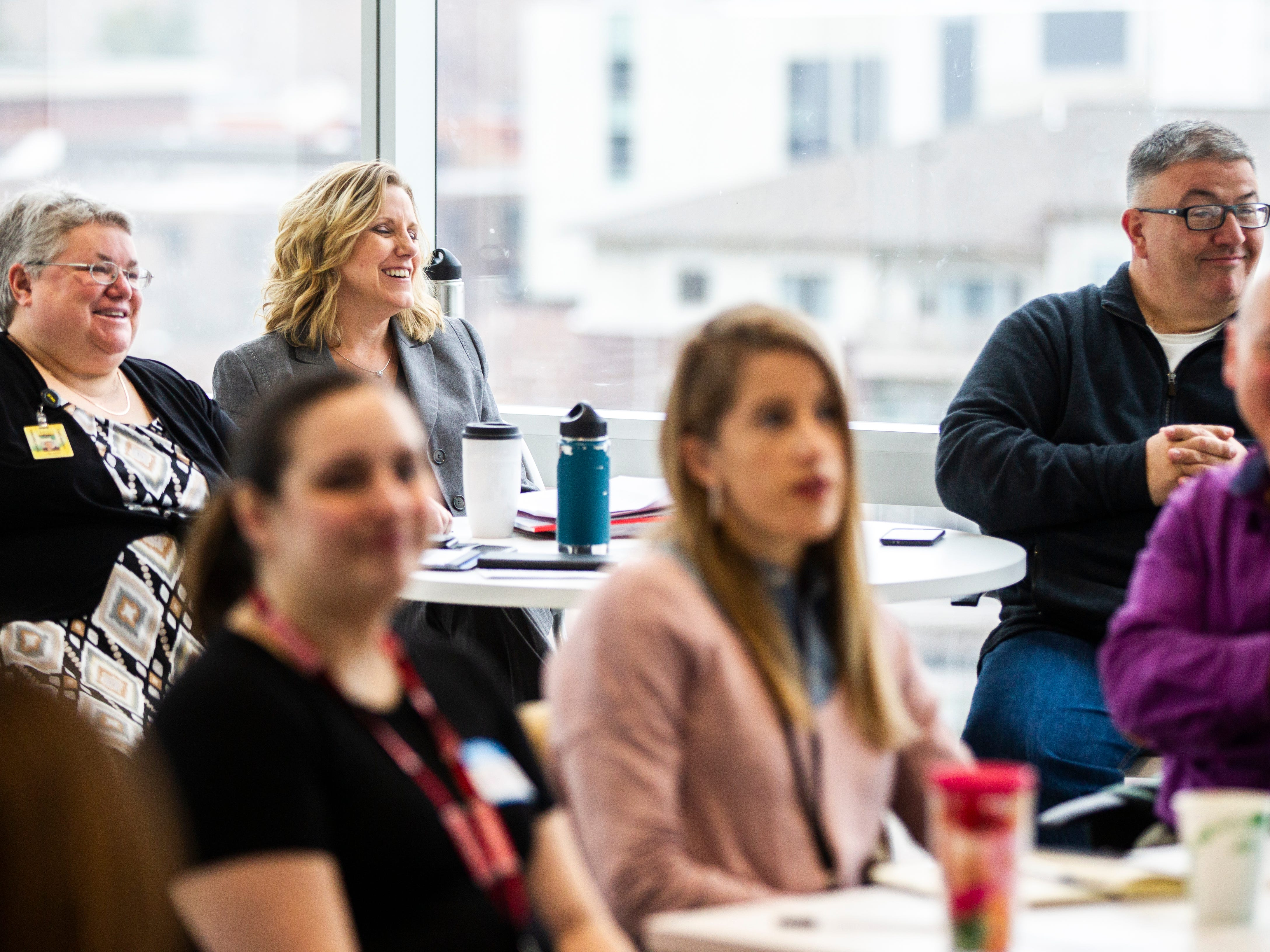 Janelle Rettig, (far left) Lynette Jacoby and Rod Sullivan sit at a table during a working group addressing the state of poverty in Johnson County on Friday, Nov. 16, 2018, on the fifth floor Penthouse Room at MidWestOne Bank in Iowa City.