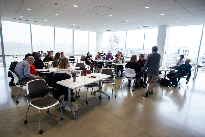 Representatives from groups in Johnson County attend a working group addressing the state of poverty in the county on Friday, Nov. 16, 2018, on the fifth floor Penthouse Room at MidWestOne Bank in Iowa City.