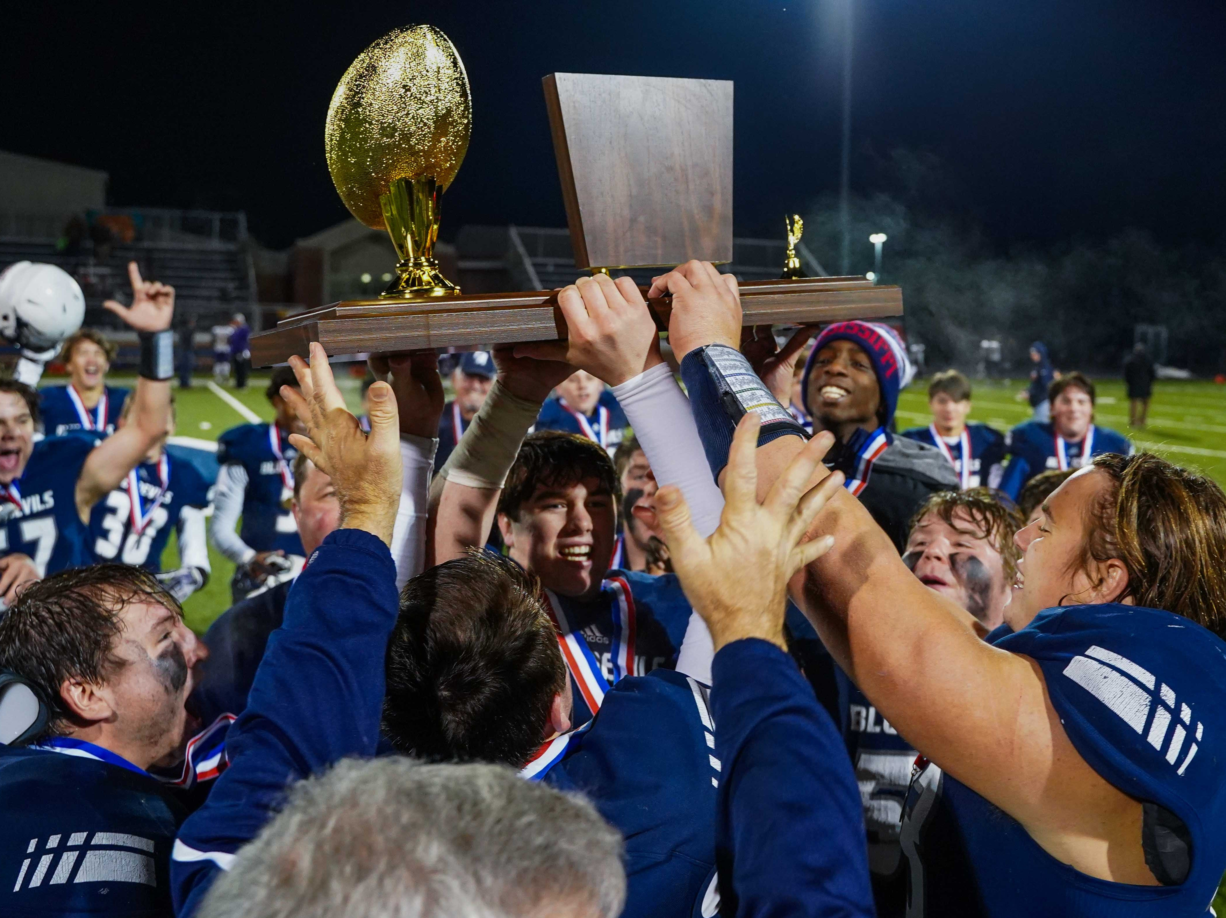 Tunica players celebrate wih the trophy following their 46-12 win over Union Christian in the MAIS Class A Championship Football game held at Jackson Academy in Jackson, MS, Thursday November 15, 2018.(Bob Smith-For The Clarion Ledger)