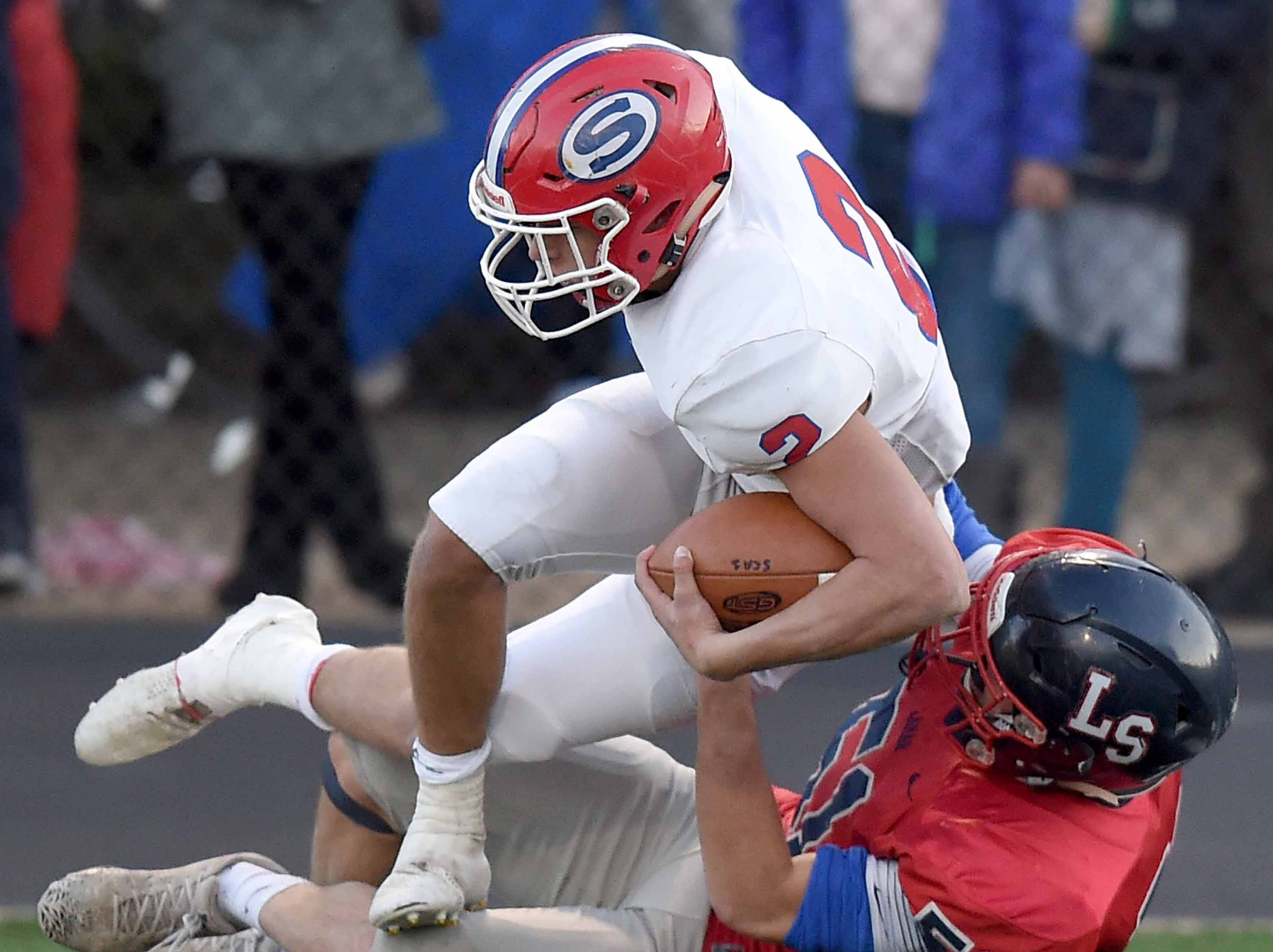 Simpson Academy's Michael Winstead (2) is tackled by Lamar School's J.T. Alridge (51) on Thursday, November 15, 2018, in the MAIS Class AAAA-D2 Football Championship at Jackson Academy in Jackson, Miss.