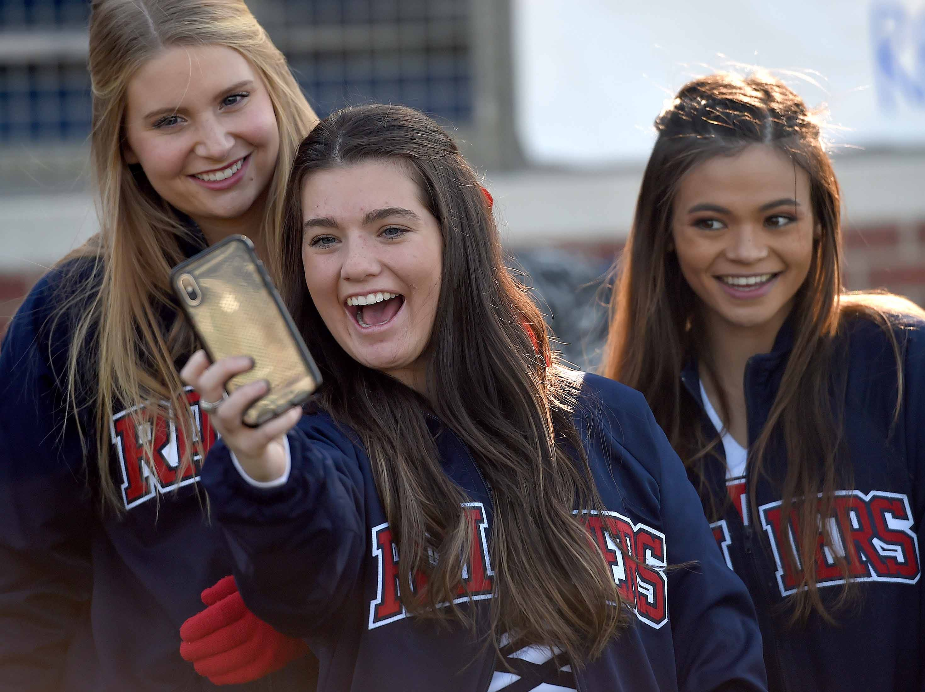 Lamar School cheerleaders take a selfie on Thursday, November 15, 2018, in the MAIS Class AAAA-D2 Football Championship at Jackson Academy in Jackson, Miss.