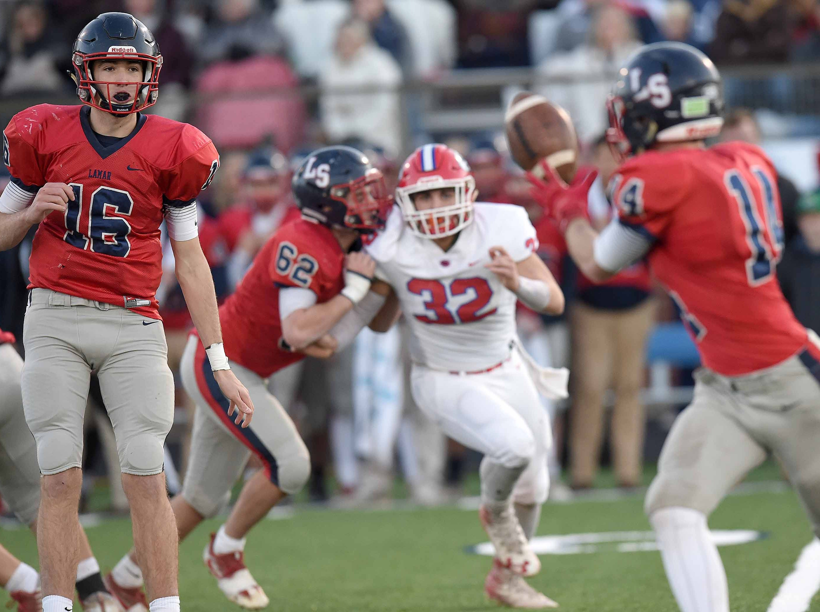 Lamar School's Joseph Hutchinson (16) pitches the ball to Jake Ransier (14) against Simpson Academy on Thursday, November 15, 2018, in the MAIS Class AAAA-D2 Football Championship at Jackson Academy in Jackson, Miss.