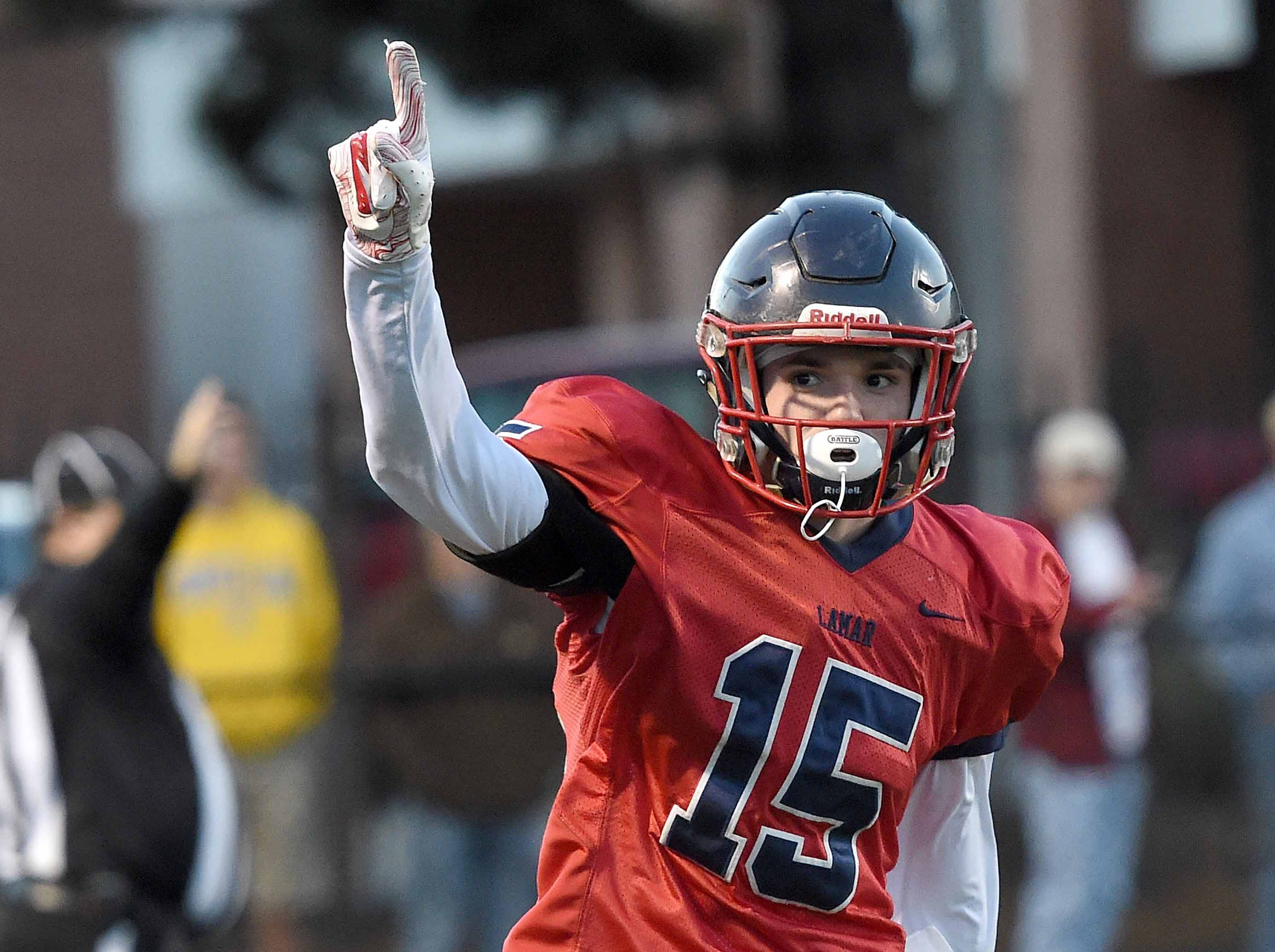 Lamar School's Brooks Brock (15) reacts after intercepting a Simpson Academy pass in the end zone on Thursday, November 15, 2018, in the MAIS Class AAAA-D2 Football Championship at Jackson Academy in Jackson, Miss.