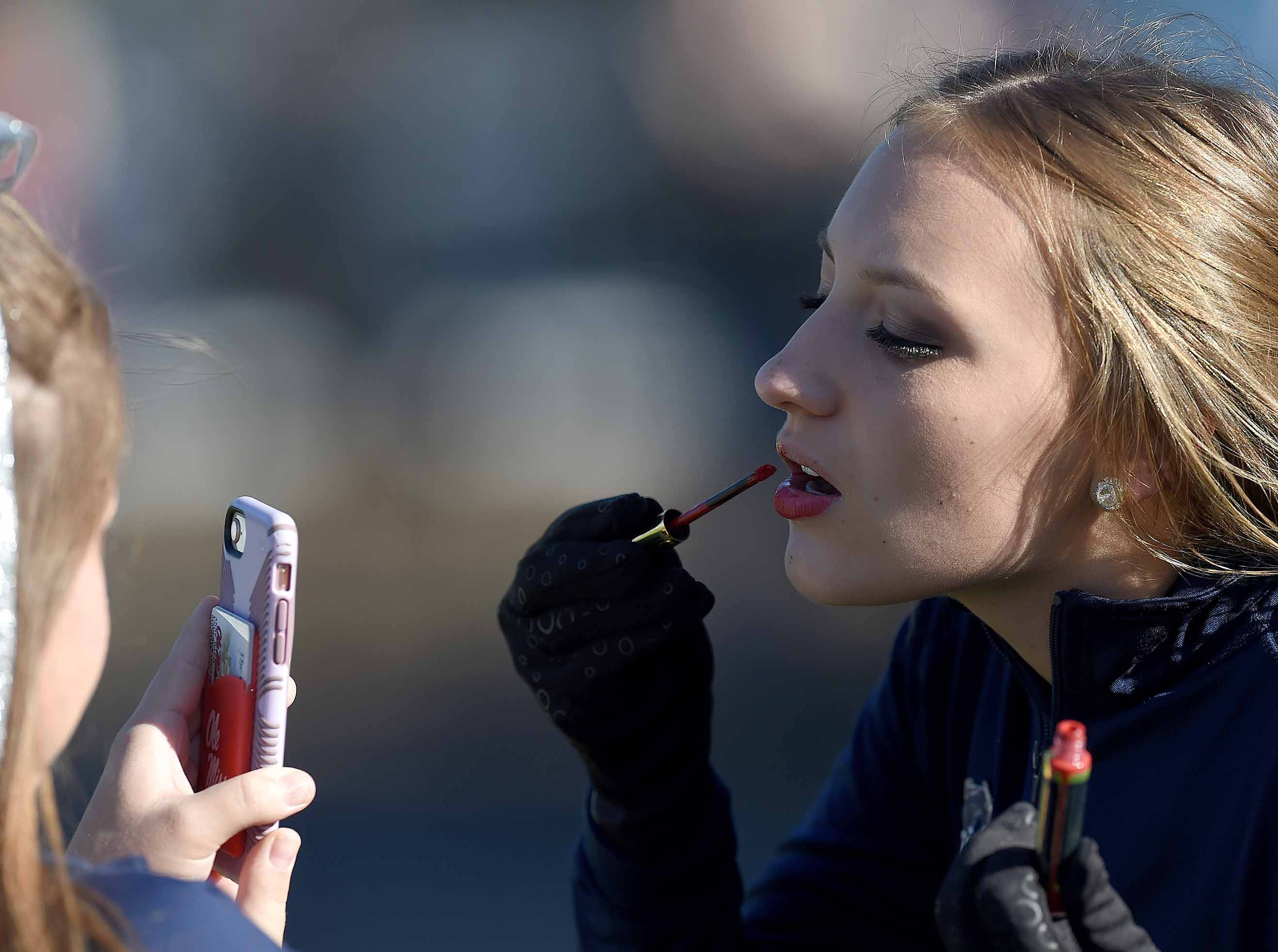 Lamar School cheerleader Emma Grace Johnson touched up her lipstick before the game on Thursday, November 15, 2018, in the MAIS Class AAAA-D2 Football Championship at Jackson Academy in Jackson, Miss.