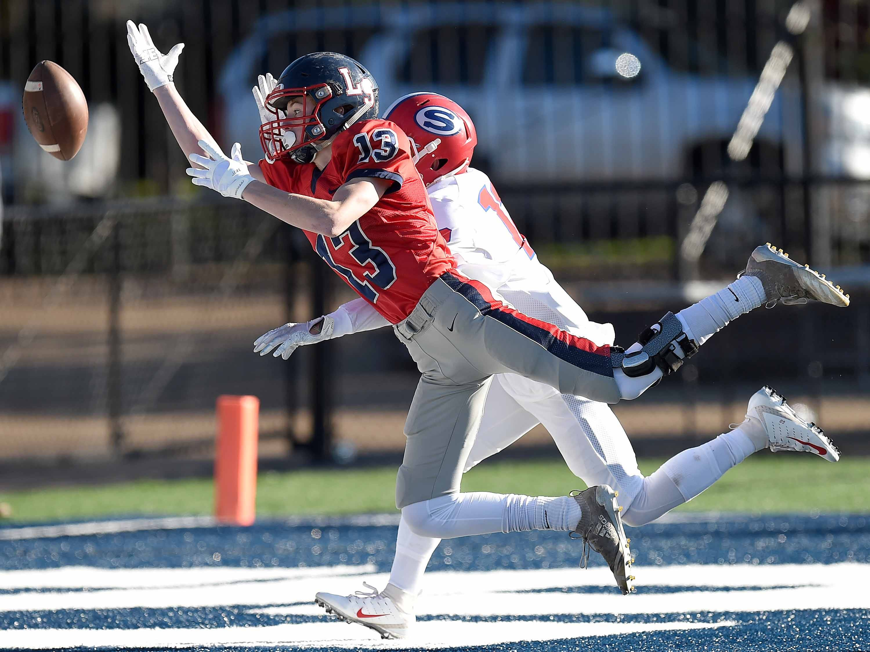 Lamar School's Jacob Partridge (13) can't find the handle on a pass in the end zone against Simpson Academy on Thursday, November 15, 2018, in the MAIS Class AAAA-D2 Football Championship at Jackson Academy in Jackson, Miss.