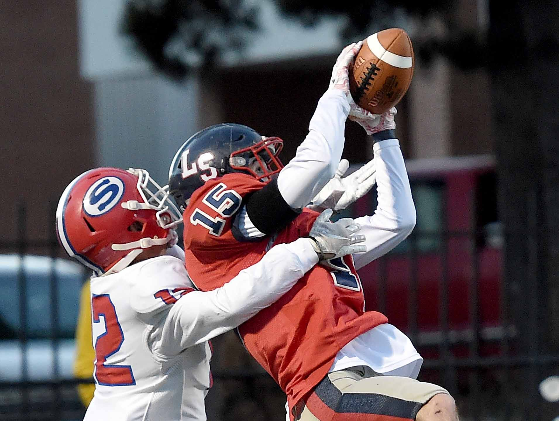 Lamar School's Brooks Brock (15) intercepts a pass for Simpson Academy's Bryce Caughman (12) in the end zone on Thursday, November 15, 2018, in the MAIS Class AAAA-D2 Football Championship at Jackson Academy in Jackson, Miss.