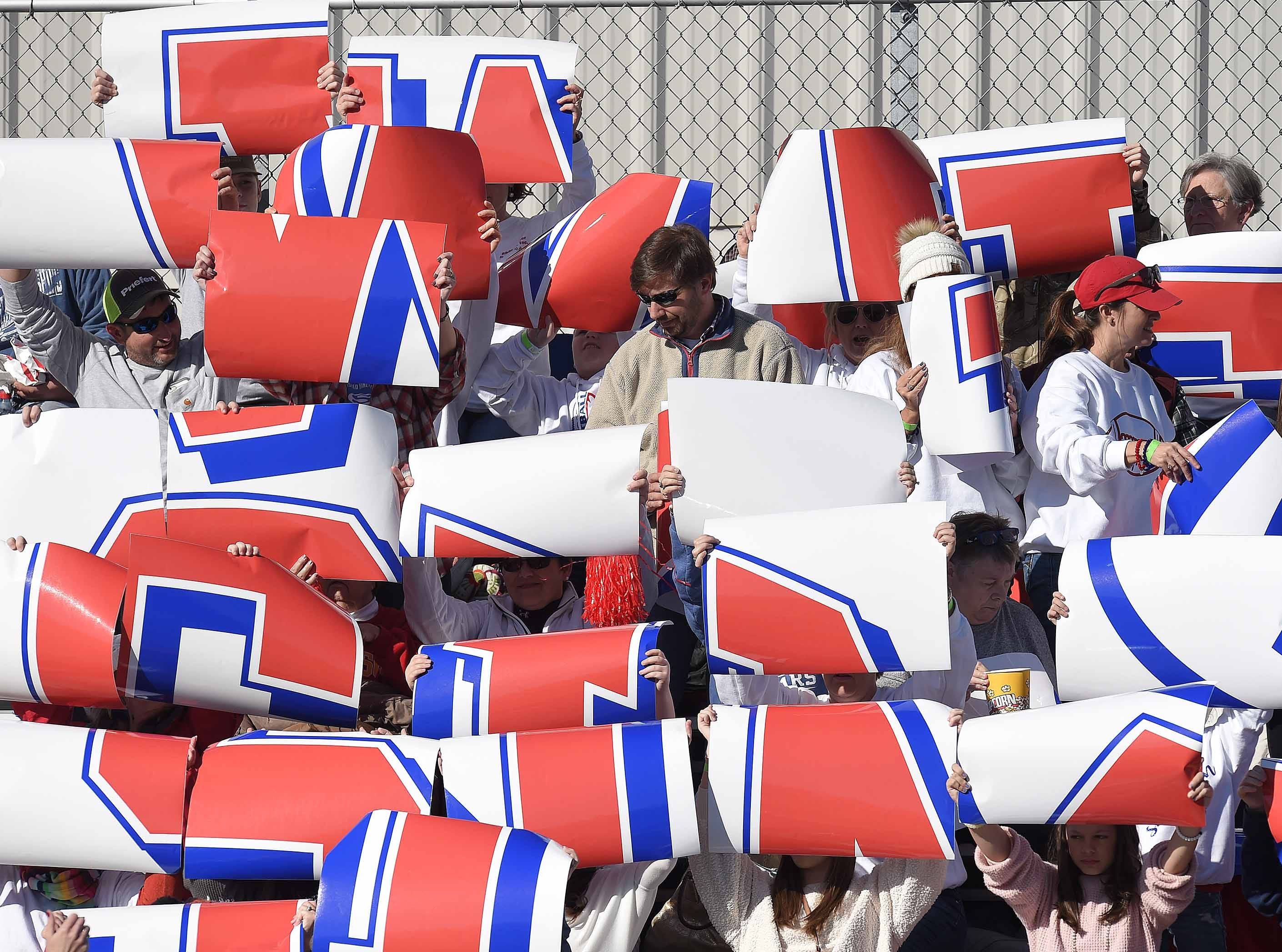 Simpson Academy fans try to build a logo in the stands on Thursday, November 15, 2018, in the MAIS Class AAAA-D2 Football Championship at Jackson Academy in Jackson, Miss.
