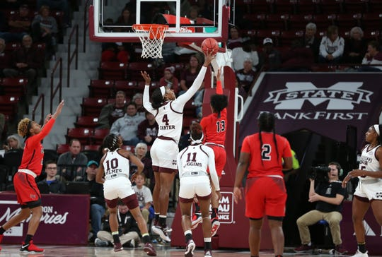 Mississippi State freshman center Jessika Carter swats the ball away from Lamar's Shedricka Pierson. Carter had four blocks in a 104-53 win.