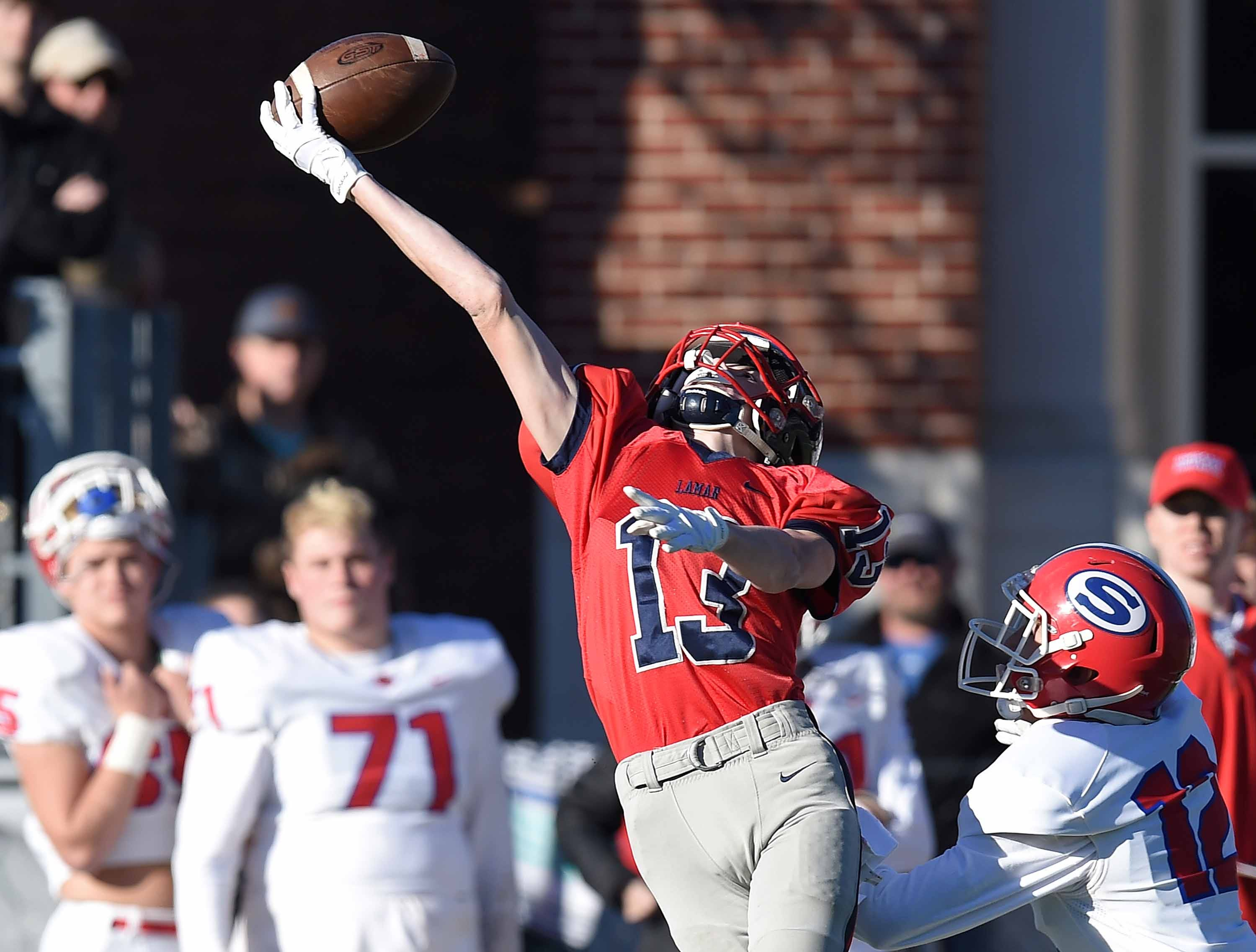 Lamar School's Jacob Partridge (13) stretches for a pass along the Simpson Academy sideline on Thursday, November 15, 2018, in the MAIS Class AAAA-D2 Football Championship at Jackson Academy in Jackson, Miss.