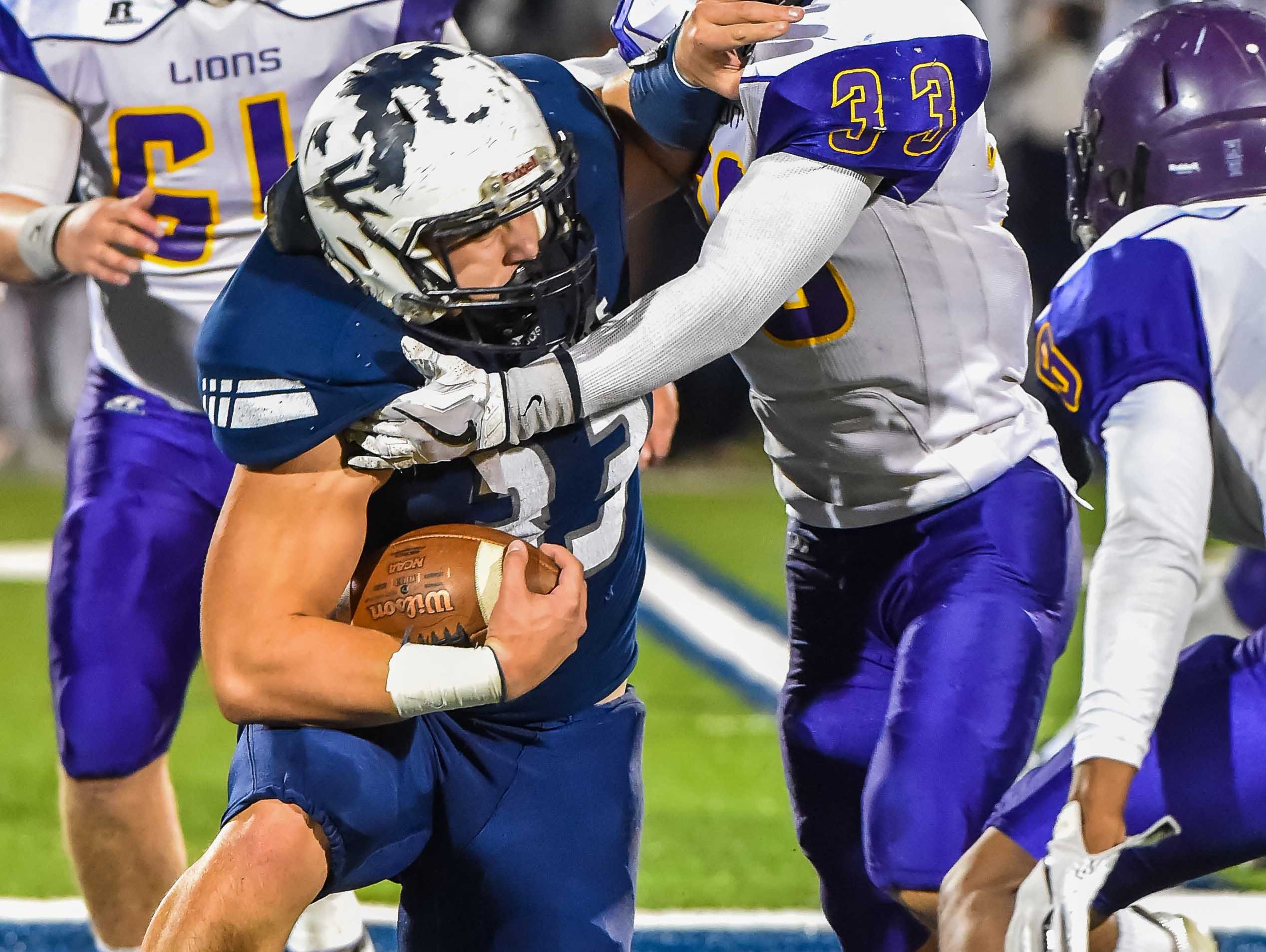 Tunica's Elijah Magee finds the going tough against Union Christian's Nick Evans (33) during the MAIS Class A Championship Football game held at Jackson Academy in Jackson, MS, Thursday November 15, 2018.(Bob Smith-For The Clarion Ledger)