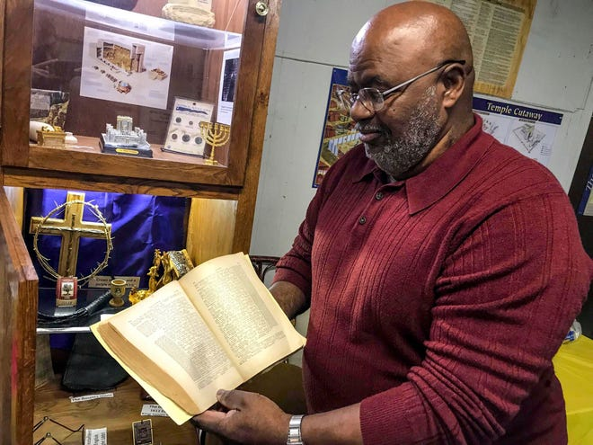 Charles Morrow holds an English-Greek bible from 1897, Nov. 15 , 2018. Whiteville, TN.