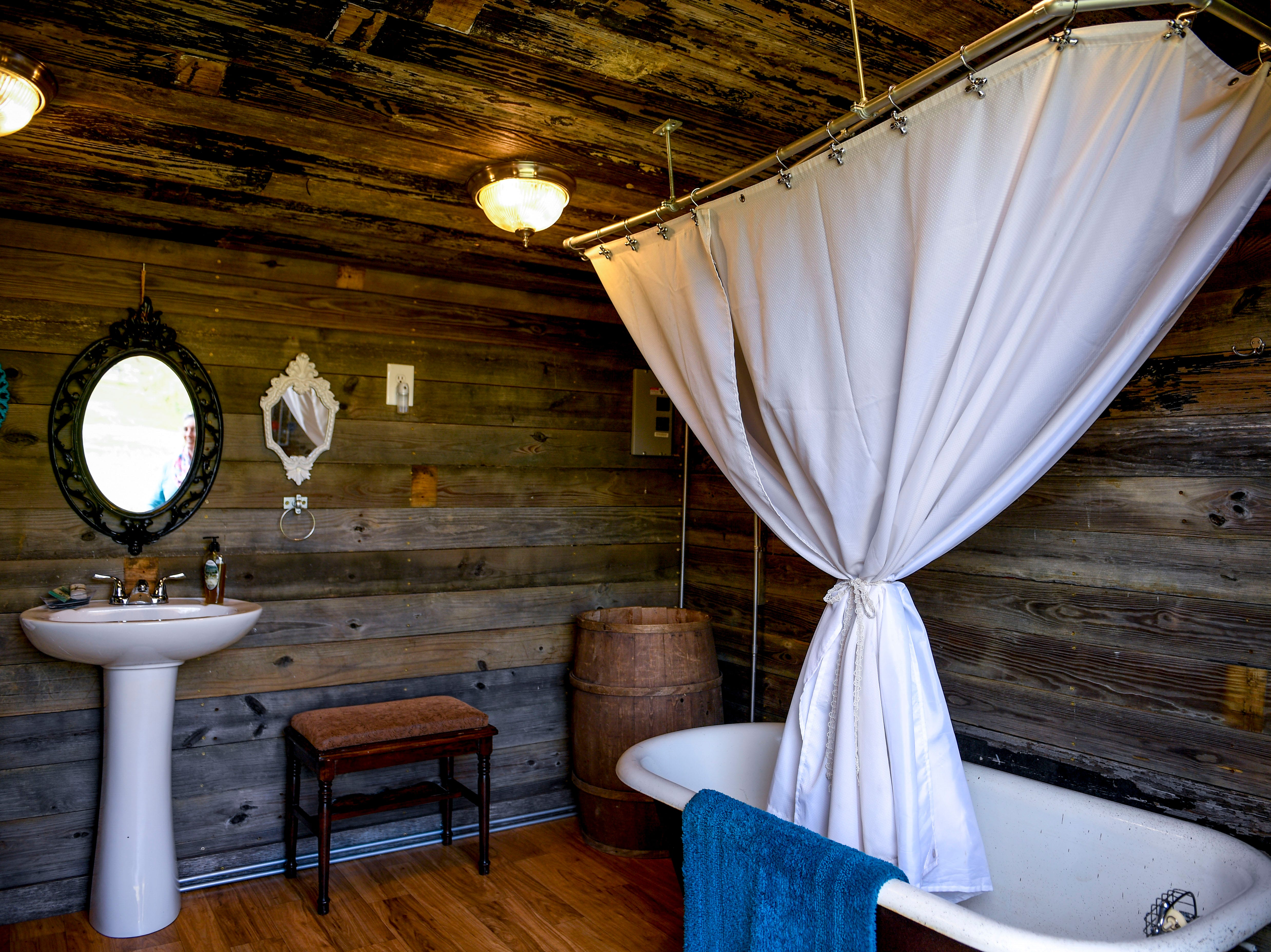 The interior of a bathroom created out of an old storage shed can be seen at Stillwaters Farm in Henderson, Tenn., on Monday, Nov. 5, 2018.