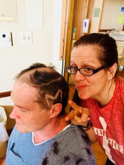 Melissa Price has a little fun while helping shave Jeffrey's head before he had brain surgery to remove a tumor in May.