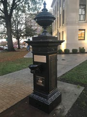 The newly refurbished WWI memorial fountain stands outside the Madison County Courthouse in Jackson, Tenn. The fountain now bears plaques explaining its history and including the names of African American soldiers who fought and died in WWI.