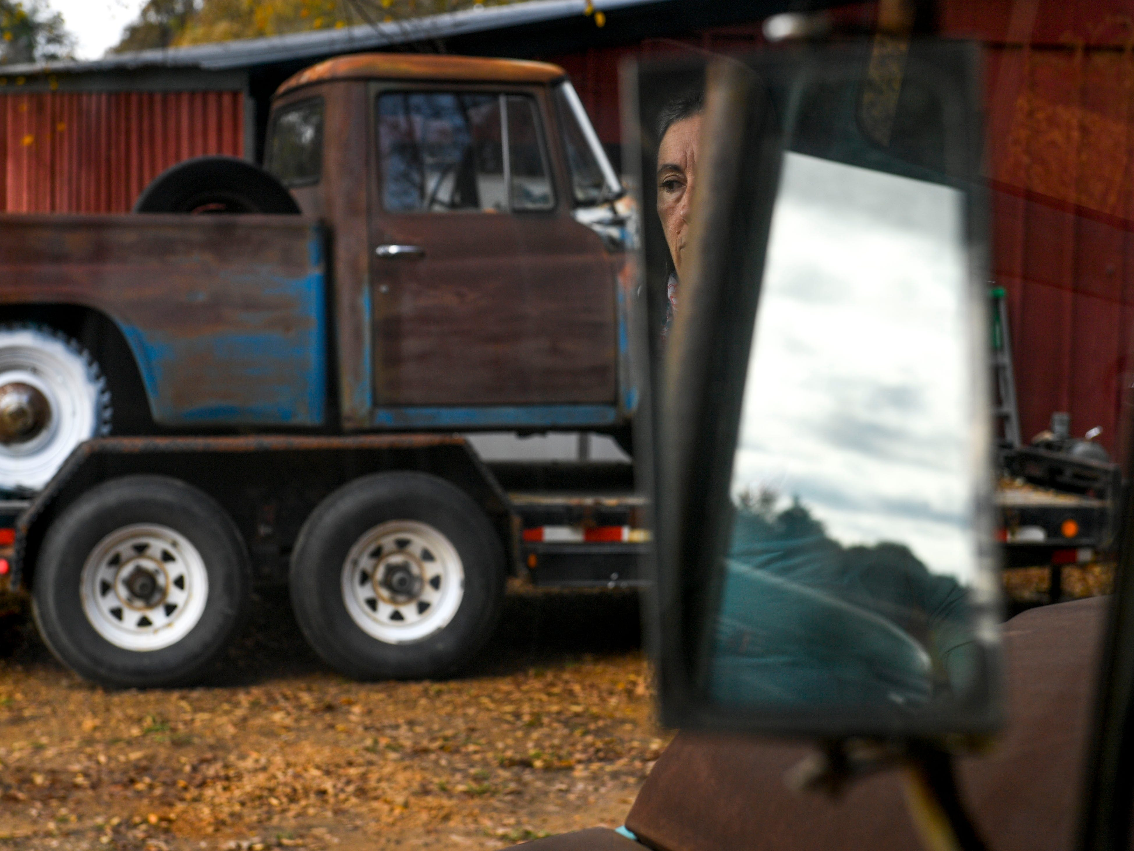 Valeria Pitoni can be seen in the reflection of a International's side mirror at Stillwaters Farm in Henderson, Tenn., on Monday, Nov. 5, 2018.