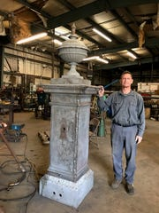 Mark Smith, owner of Heritage Forge and Wrought Iron, stands next to the WWI memorial fountain during the restoration process. The fountain, which will no longer be connected to running water, will be dedicated on Nov. 17.