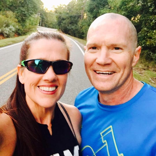 Jeffrey and Melissa Price pose for a selfie before a run earlier this year.