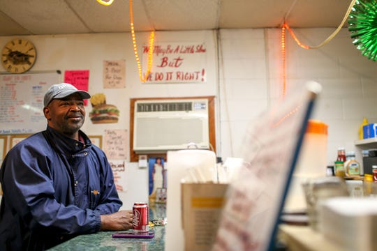 Mac's longtime friend Anthony Taylor sits at the counter and talks with the cook at Mac's BBQ in Jackson, Tenn., on Tuesday, Nov. 13, 2018.