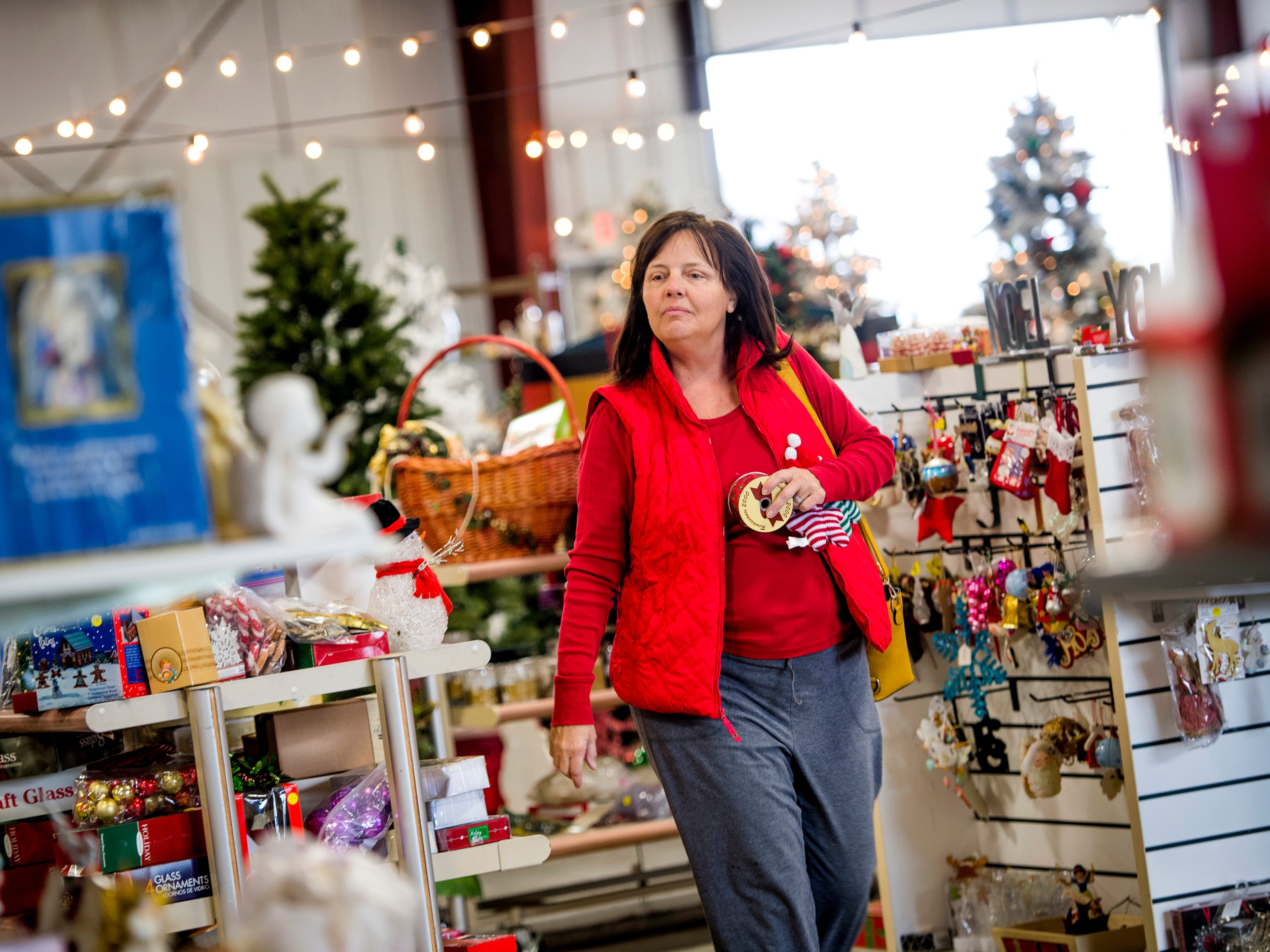 Customers browse Christmas decorations for sale at the KARM Christmas Store located at 9629 Parkside Drive in Knoxville on Tuesday, November 13, 2018.