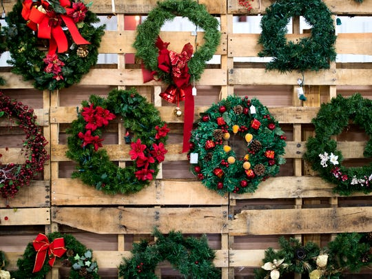 Wreaths for sale are hung at the KARM Christmas Store located at 9629 Parkside Drive in Knoxville on Tuesday, November 13, 2018.