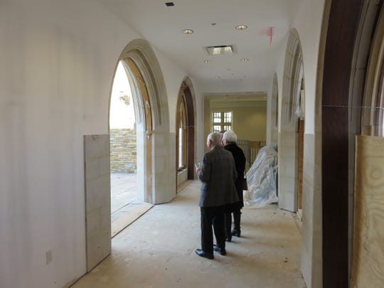 New hallway from nave and narthex lined with arches.