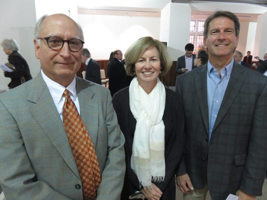 Building Committee chair Dr. Amy Cathey, center, with church project committee volunteers Karl Caughman, left, and David Collins.