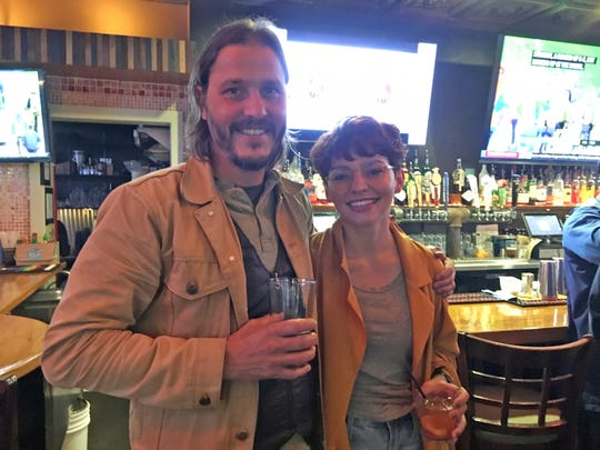 Matthew DeBardeleben of Blühen Botanicals and Ryan-Ashley Anderson of Smart & Becker kick back and enjoy the company of other Knoxville business professionals.