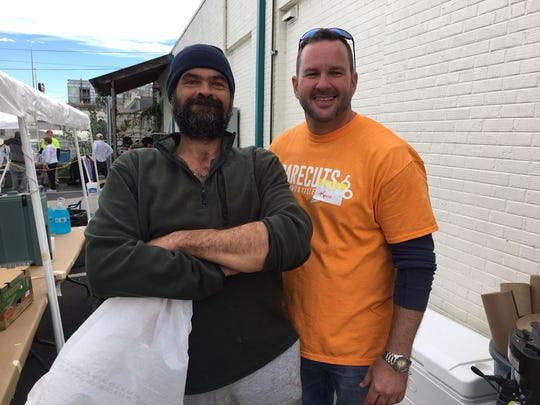 """Team leader Kevin Tipton (right) says of longtime pal Luther Perry, """"He helps. He picks up trash and cigarette butts, and he's still here at the end of the day."""""""