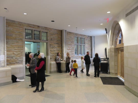 The curved hall of Church Street's new welcome center gets a first look during ceremony.
