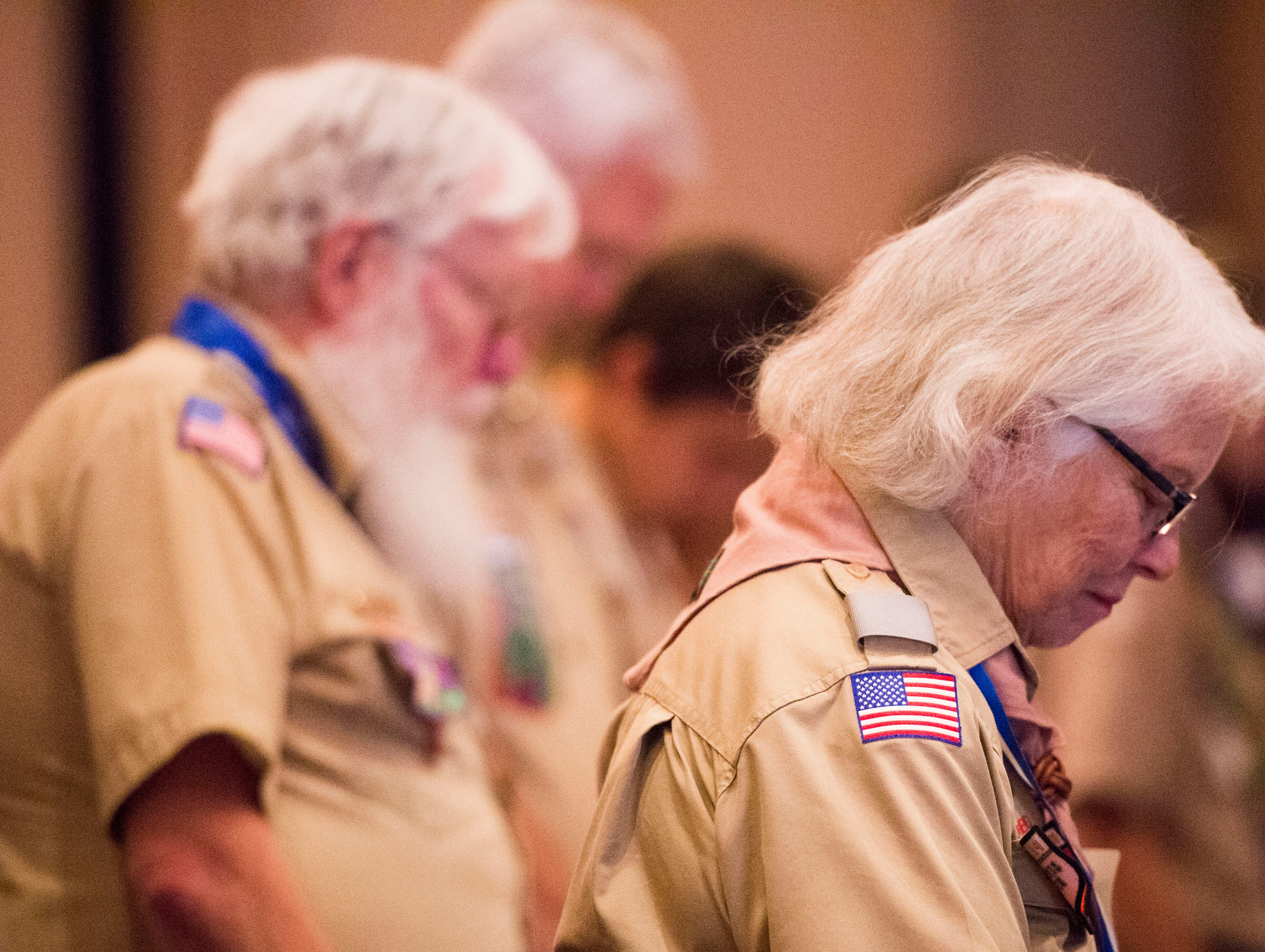 Sandra Lee prays at the 2018 Eagle Scout gathering held at Hotel Knoxville Thursday, Nov. 15, 2018. Sam Beall received the Silver Beaver award at the event, which is the highest award in scouting.