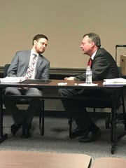 Devin Lyon, left, and Nathan Rowell, two city attorneys opposing Steve King's challenge to his job loss, at the hearing held Nov. 14.