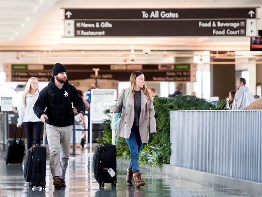 Arriving passengers leave the terminal at McGhee Tyson Airport on Friday, November 16, 2018.