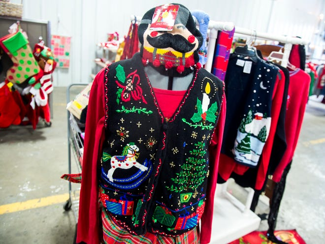 Christmas sweaters for sale at the KARM Christmas Store located at 9629 Parkside Drive in Knoxville on Tuesday, November 13, 2018.