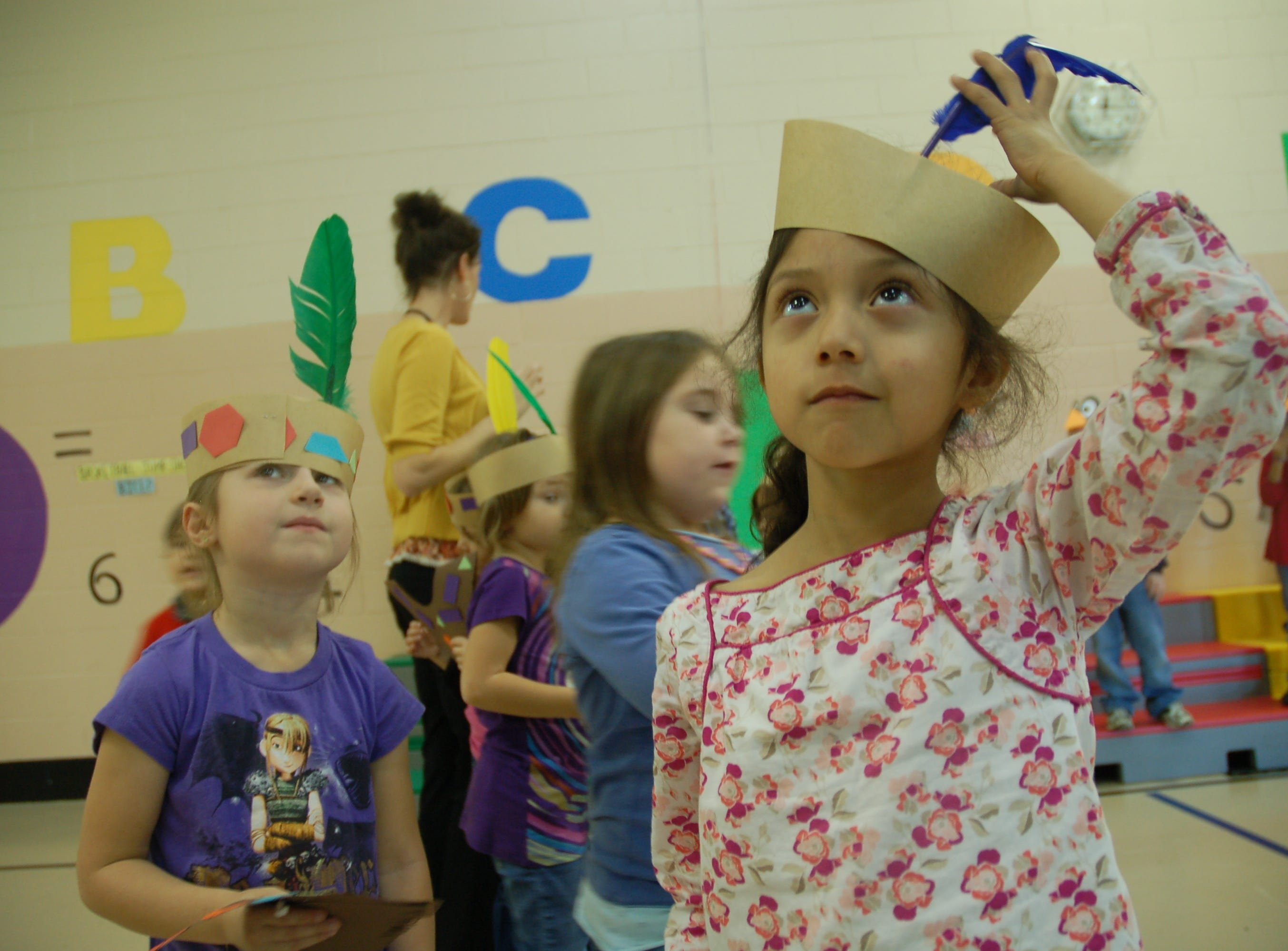 Dogwood Elementary kindergardeners Melia Underwood, left, and Ashlyn Felipe-Diaz on Monday, Nov. 22, 2010, take a break from rehearsing the class play ``Hooray for Thanksgiving,'' that will be performed in the school's gymnasium.