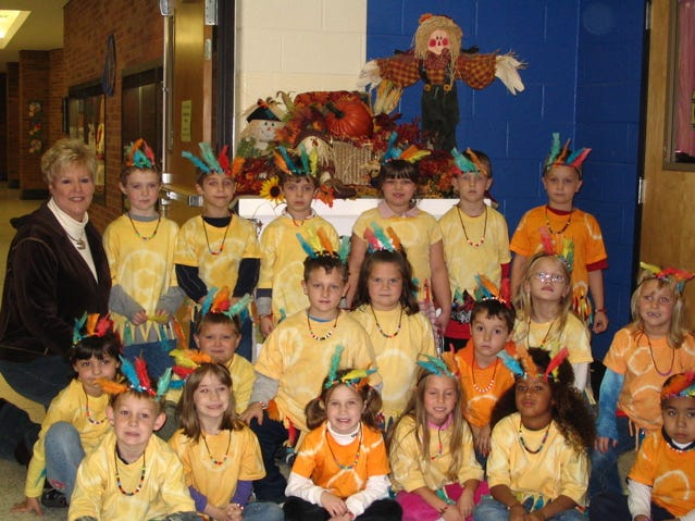 DeeAnn Collins' first-grade class at Karns Elementary School celebrated Thanksgiving by hosting a feast day. The students prepared a lot of their own food for the feast. They had vegetables and dip, corn on the cob, muffins, fruit salad, and turkey and dressing. The class includes, from left, front row, Morgan Jones, Beth Puleski, Hannah Kay Callahan, Haley Bell, Olivia Quanonis, William Cortez; second row, Haley Barger, Reese Hooks, Nick Miles, Kayla Chambers, Jacob Schubert, Sydney Vance, Hailee Stuart; third row, Collins, Andrew Knight, Ben Osborne, Mark Cate, Kerri Anna Branum, Weston Bebe and Liam Bradley.
