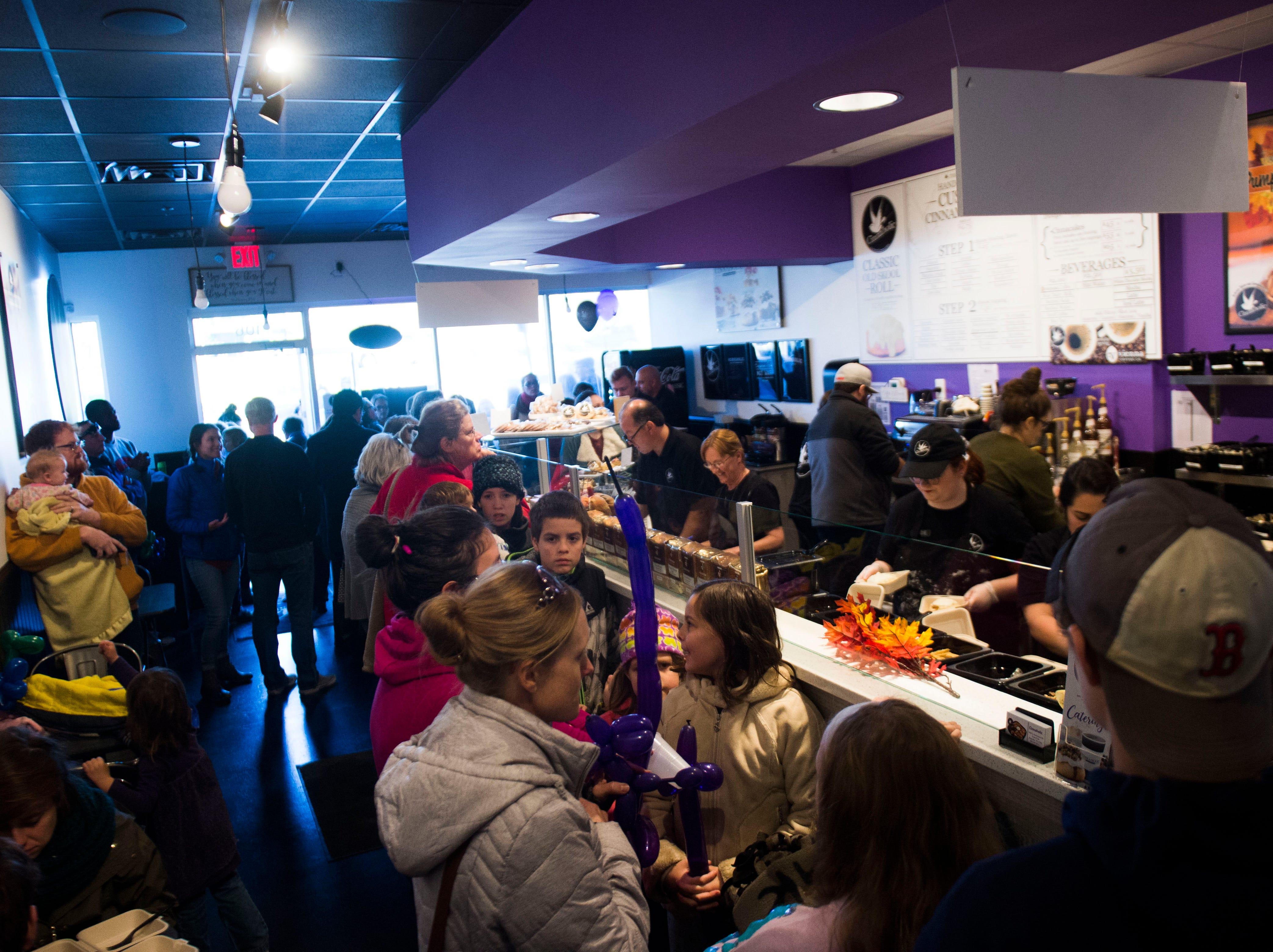 Patrons fill Cinnaholic at it's grand opening at 9450 S. Northshore Drive Friday, Nov. 16, 2018. Cinnaholic is a vegan bake shop.
