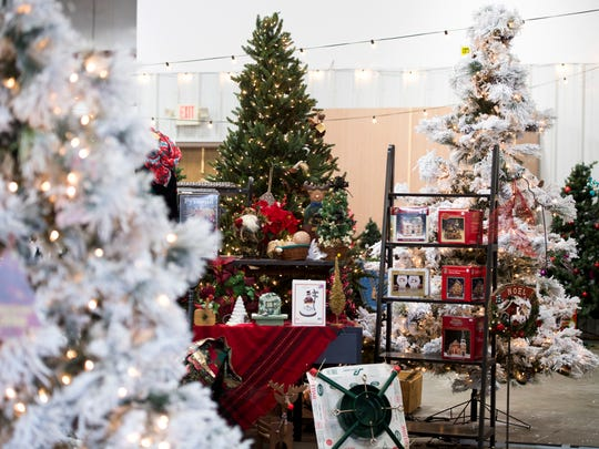 christmas trees and other decorations for sale at the karm christmas store located at 9629 parkside