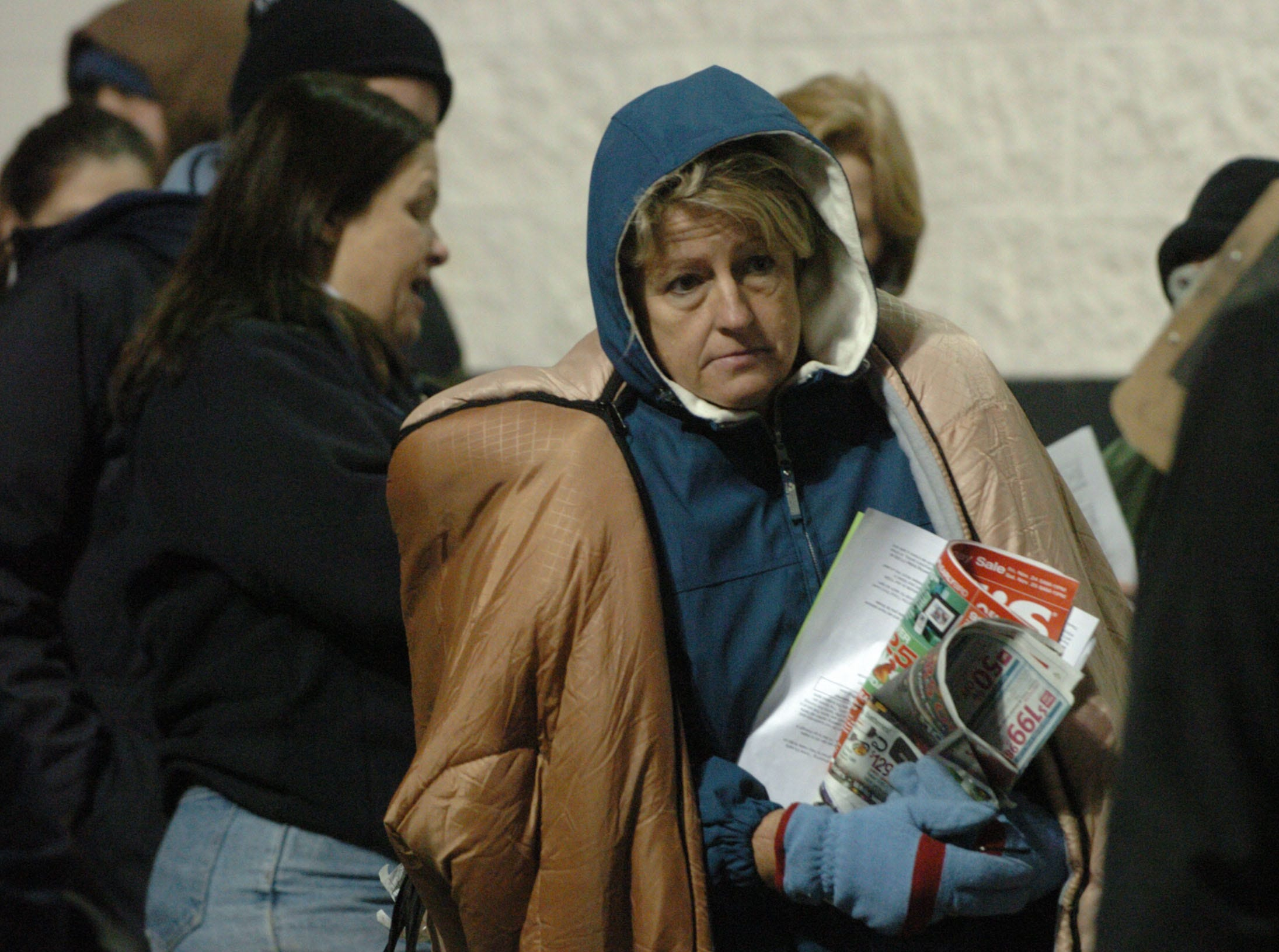 Debbie Farmer of Kingston stands near the front of the line at Best Buy early Friday morning. Farmer had a sleeping bag to help her stay warm during her all night vigil to purchase a big screen television.  Farmer  got in line at 8 p.m. Thanksgiving Day.