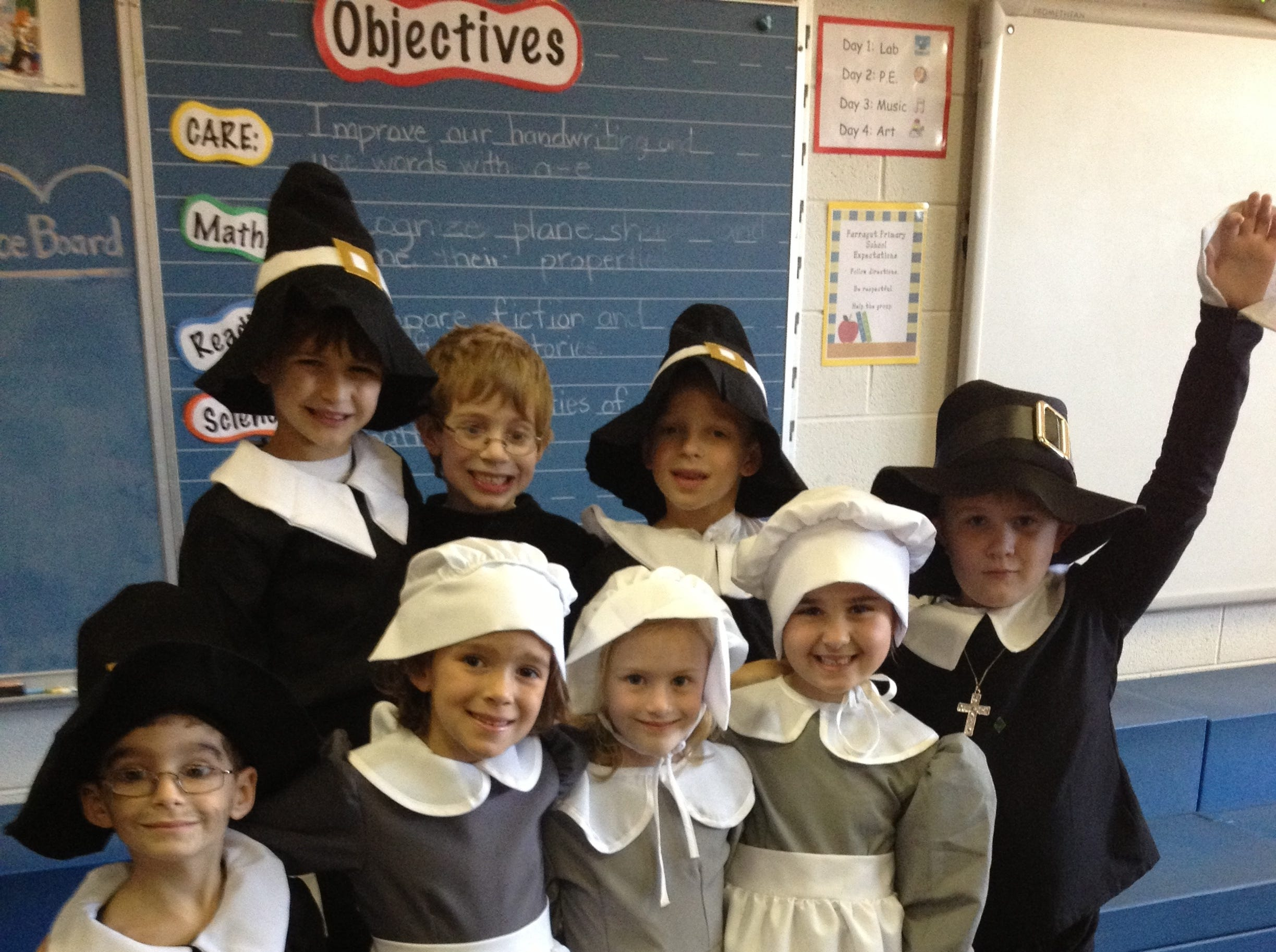 Brooke Maner's first grade class at Farragut Primary School put on a Thanksgiving play for students' friends and family. Students dressed as pilgrims are, first row, from left, Jake Javors, Anna Beth Reiman, Caroline Golebiewski, Aubrie Diedrick, Adam Cagle; second row, Daniel Moon, Reid Ellington and Jaden McChristian.